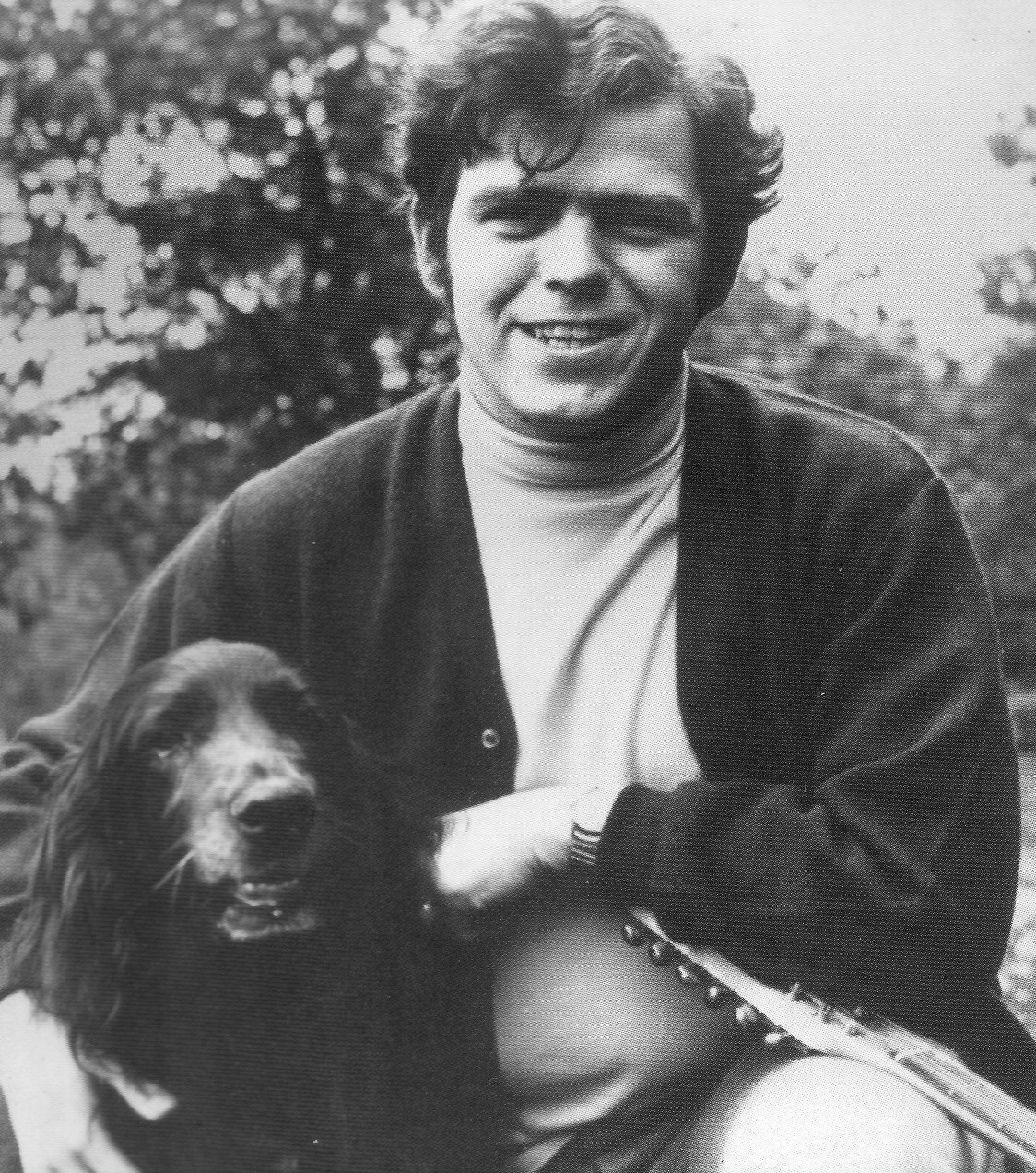 Photo: a younger Tim, with spaniel